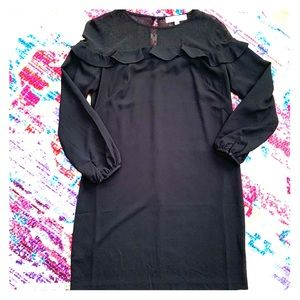 Black swing dress with button detail